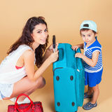 Child with mother ready to travel to Europe, France Royalty Free Stock Photos