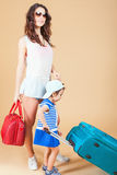 Child with mother ready to travel to Europe, Italy Stock Photos