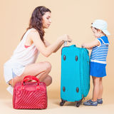 Child with mother ready to travel to Europe, Milan Stock Images