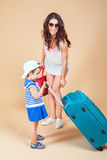 Child with mother ready to travel to Europe, Milan Stock Photo