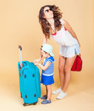 Child with mother ready to travel to Europe, Paris Stock Image
