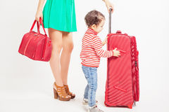 Child with mother ready to travel Royalty Free Stock Image