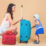 Child with mother ready to travel Stock Photography