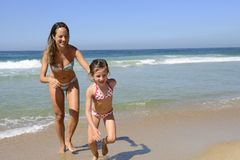Child and mother running on Stock Images