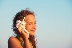 Girl on sea background stock photography
