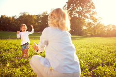 Child with mother spend time. Lovely child with mother spend time in sunny park Stock Photo