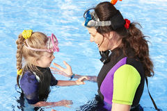 Child with mother in swimming pool . Royalty Free Stock Photos