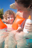 Child with mother in swimming pool Stock Photos