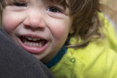 Child in mothers arms closeup. Child crying in mothers arms closeup Stock Images