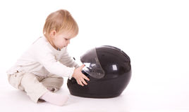 Child from motor-cycle helmet Royalty Free Stock Image