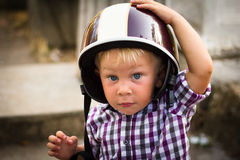 Child with motorbike helmet Royalty Free Stock Image