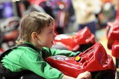 Child on motorcycle simulator Stock Photo