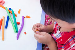 Child moulding modeling clay. Strengthen the imagination Stock Image