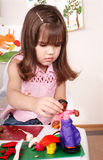 Child moulding of plasticine . Royalty Free Stock Image