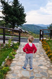 Child in a Mountain resort in a rainy day Royalty Free Stock Images