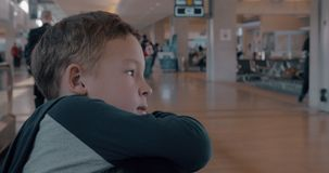 Child on moving walkway at the airport stock footage
