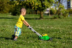 Child mowing grass Royalty Free Stock Photography
