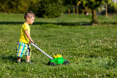 Child mowing grass Stock Photography