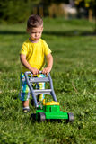 Child mowing grass Stock Image