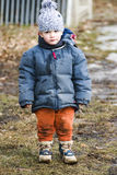 Child with muddy clothes Royalty Free Stock Image