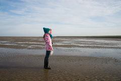 Child during mudflat hiking tour Royalty Free Stock Photo