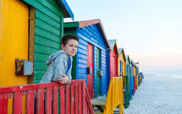 Child at Muizenberg beach. Child playing at famous colorful huts of Muizenberg beach near Cape Town in South Africa Royalty Free Stock Photos