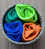 The Child multicoloured socks in the round crib Stock Photography