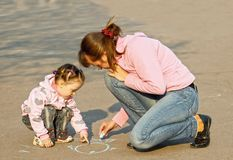 The child with mum draw a chalk Royalty Free Stock Images