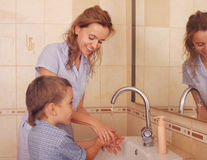 Child with mum wash hands Royalty Free Stock Images