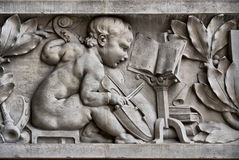 Child musician on a frieze Royalty Free Stock Image
