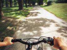 Child nands on the handlebar close up image stock images