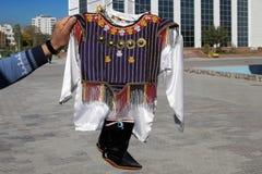 Child national wear. Turkmenistan. Ashkhabad market. Child national wear. Turkmenistan. Ashkhabad market royalty free stock image