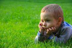 Child in nature. Cute face. Outdoor Stock Image