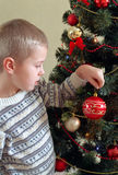 Child near christmas tree Royalty Free Stock Photography
