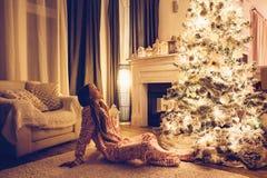 Child near Christmas tree stock photography