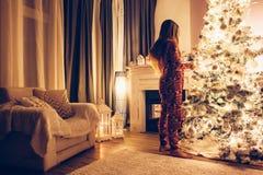 Child near Christmas tree Stock Image
