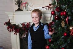 Child near Christmas tree Royalty Free Stock Photography