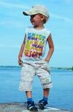 Child near river Stock Photos