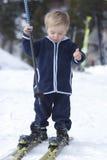 Child near skies Royalty Free Stock Image