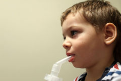 Child with nebulizer Royalty Free Stock Images