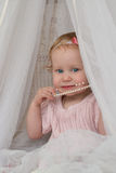 Child with a necklace of pearls. Baby girl with a necklace of pearls Royalty Free Stock Photos