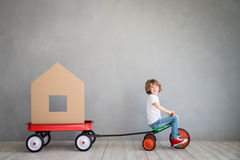 Child New Home Moving Day House Concept Stock Photos