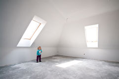 Child in new loft room. Small child in new loft room with windows and white walls royalty free stock photos