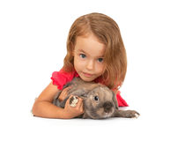 Child in the New Year hat with a rabbit. Stock Photography