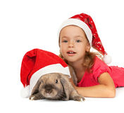 Child in the New Year hat with a rabbit. Royalty Free Stock Photography