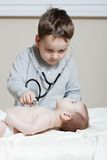 Child with newborn Stock Photo