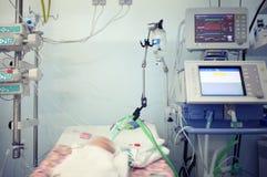 Child in the newborn intensive care unit Stock Photo
