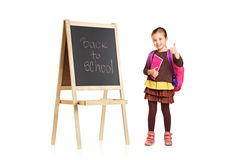 Child next to a board showing thumb up Royalty Free Stock Image