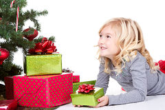 Child next to a Christmas tree Stock Image