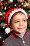 Child next to Xmas tree Royalty Free Stock Image